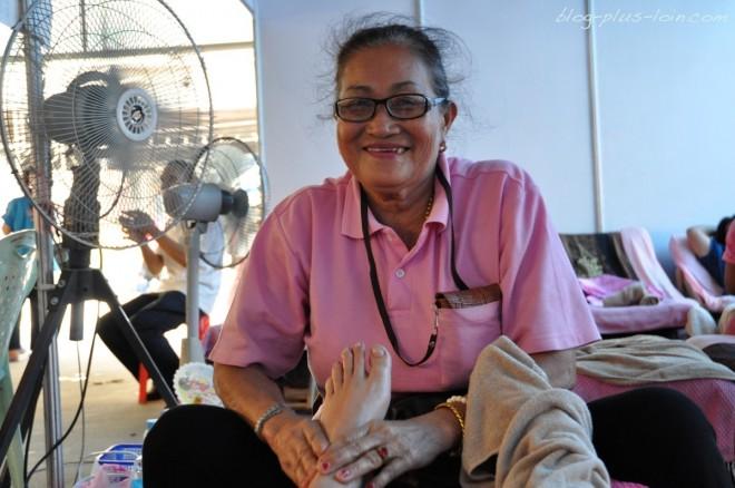 Massage des pieds, à Bangkok.